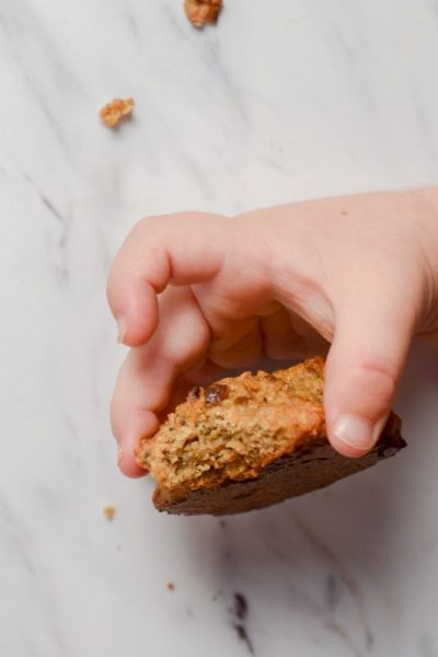 toddler holding healthy oatmeal cookie