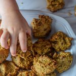 toddler reaching for breakfast cookies