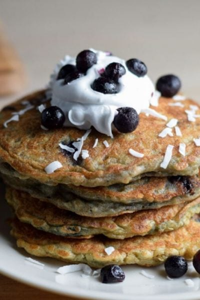 dairy free pancake stack with coconut cream and blueberries