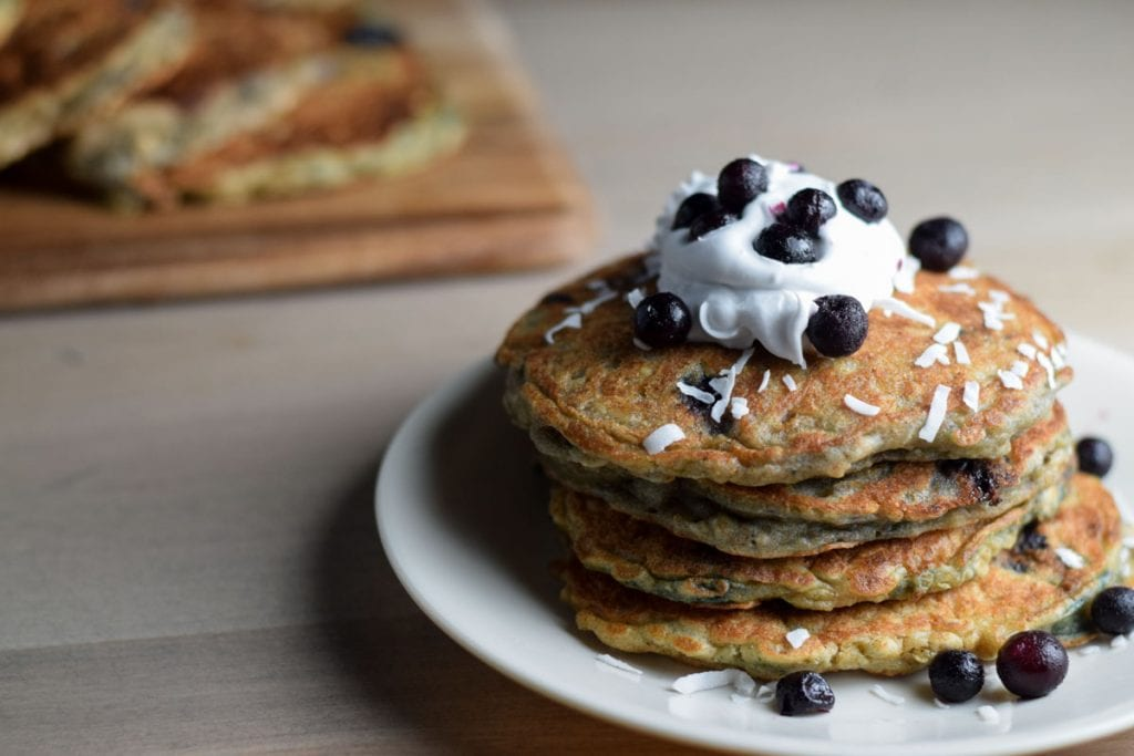 dairy free pancakes with coconut cream and blueberries