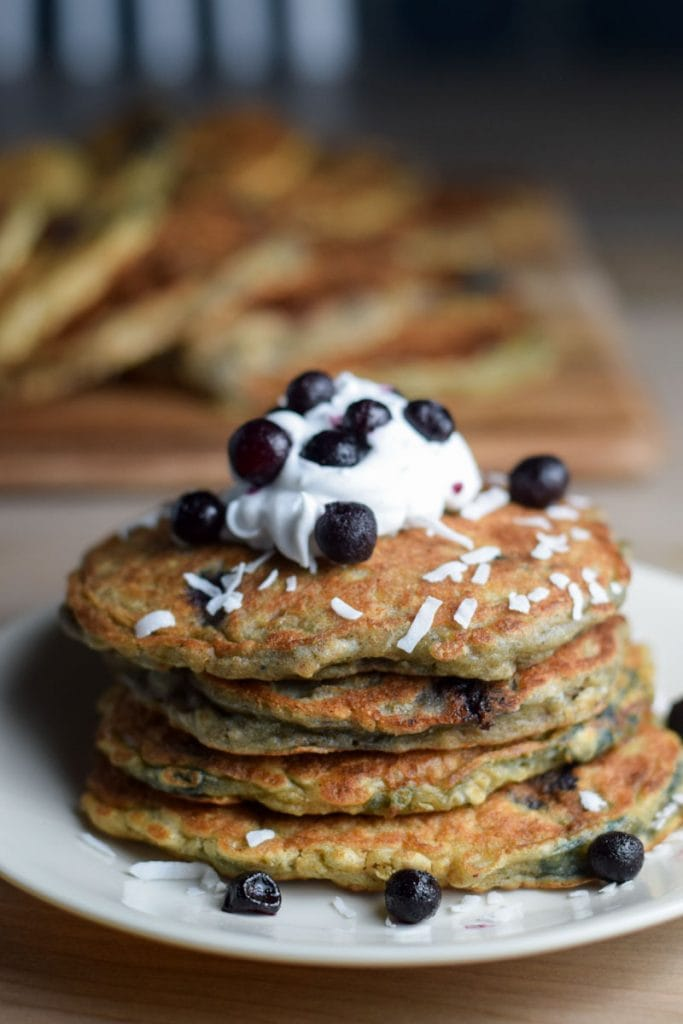 coconut cream dairy free pancakes with blueberries and coconut cream whipped cream