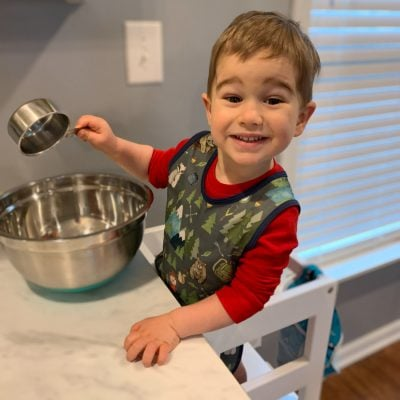toddler cooking in kitchen helper tower