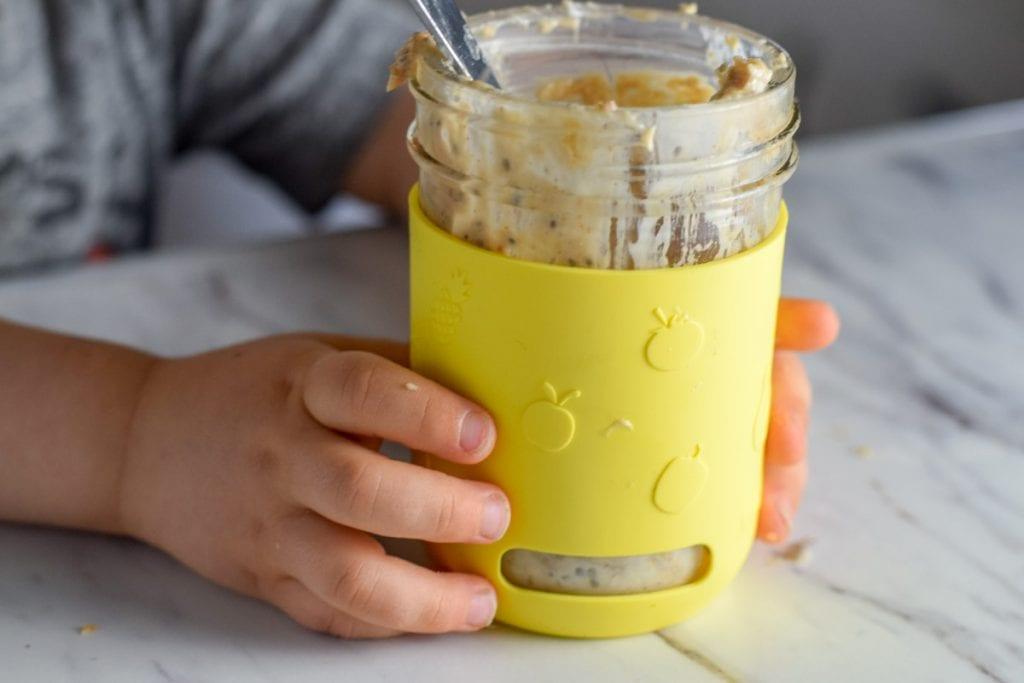 toddler eating banana overnight oats