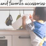 "text reads ""adorable toddler kitchen sets and favorite accessories"" with picture of a boy pretending to play kitchen"