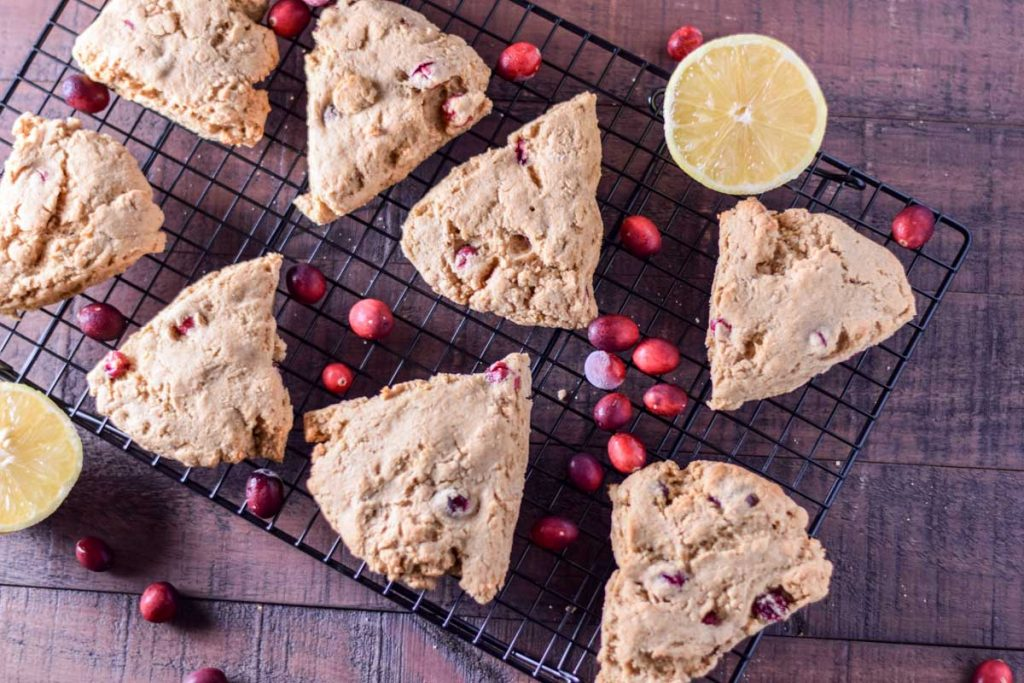 healthy scones on a cooling rack with lemon and cranberries