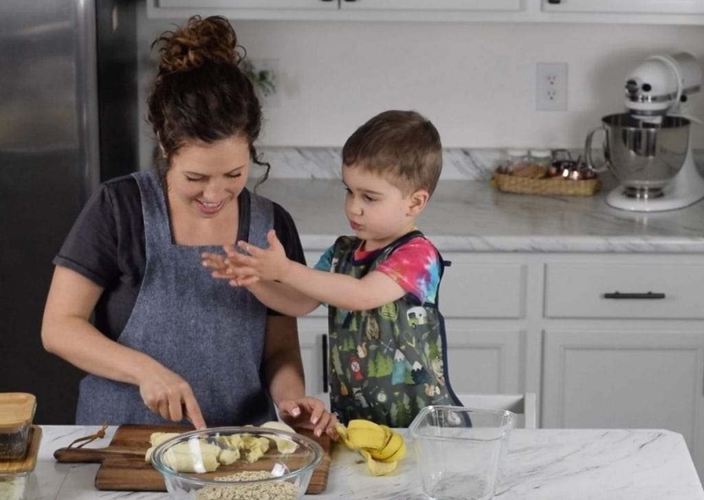 mother cooking with toddler